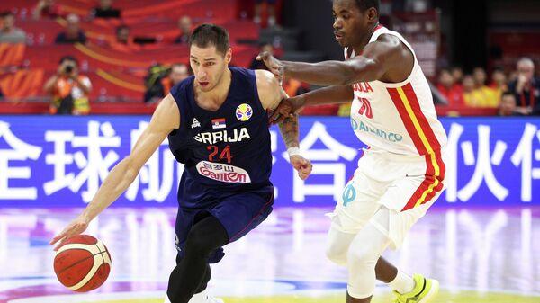 Игровой момент матча баскетбольного Кубка мира Ангола - Сербия