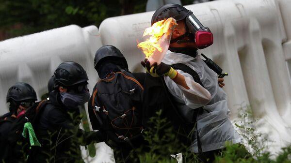Демонстрант на акции протеста в Гонконге, Китай. 31 августа 2019