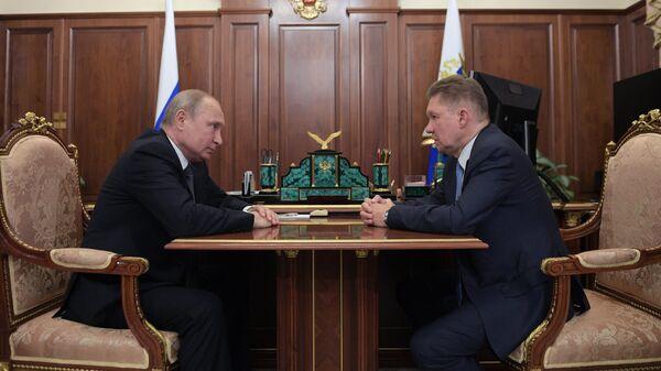 Президент РФ Владимир Путин и председатель правления ПАО Газпром Алексей Миллер