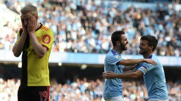 Manchester City's Portuguese midfielder Bernardo Silva (C) celebrates with Manchester City's Spanish midfielder David Silva (R) after he scores the team's seventh goal during the English Premier League football match between Manchester City and Watford at the Etihad Stadium in Manchester, north west England, on September 21, 2019. (Photo by Oli SCARFF / AFP) / RESTRICTED TO EDITORIAL USE. No use with unauthorized audio, video, data, fixture lists, club/league logos or 'live' services. Online in-match use limited to 120 images. An additional 40 images may be used in extra time. No video emulation. Social media in-match use limited to 120 images. An additional 40 images may be used in extra time. No use in betting publications, games or single club/league/player publications. /