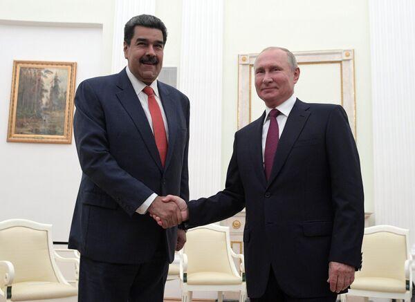 Президент РФ Владимир Путин и президент Венесуэлы Николас Мадуро во время встречи