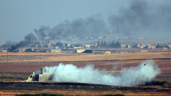 Дым от бомбардировок на северо-востоке Сирии. 9 октября 2019