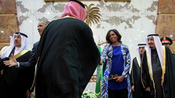 Первая леди США Мишель Обама и король Саудовской Аравии Салман ибн Абдул-Азиз Аль Сауд в Эр-Рияде. 27 января 2015