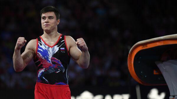Никита Нагорный (Россия) после выполнения опорного прыжка в финале соревнований на чемпионате мира по спортивной гимнастике в Штутгарте.