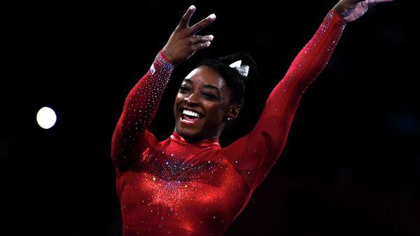 Симона Байлз (США) на чемпионате мира по спортивной гимнастике в Штутгарте.