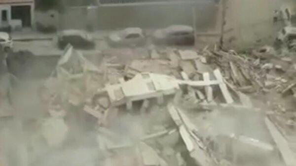 Стоп-кадр видео обрушения здания в городе Форталеза в Бразилии