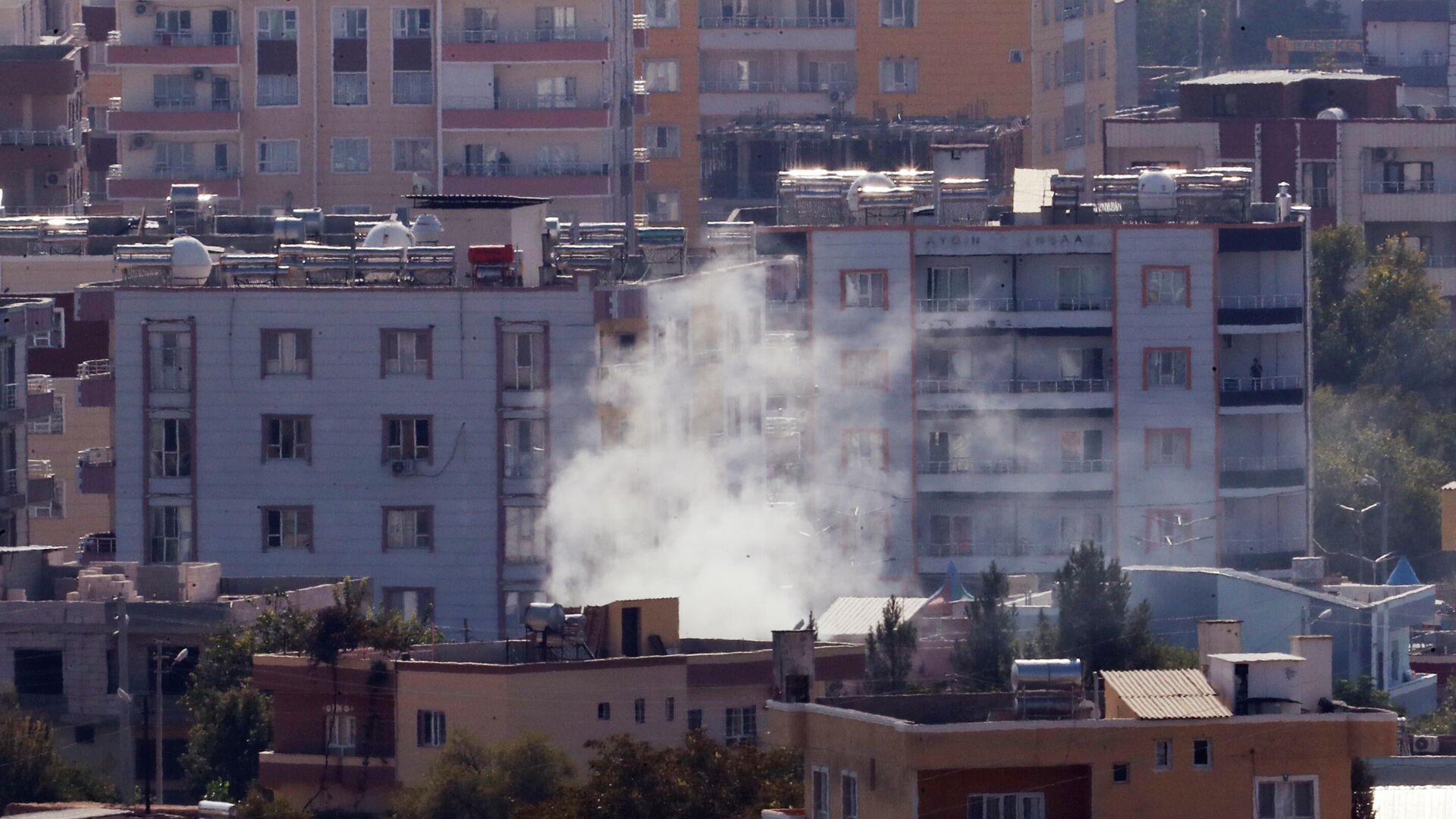 Дым над сирийским городом Рас-эль-Айн. 18 октября 2019 - РИА Новости, 1920, 11.09.2020