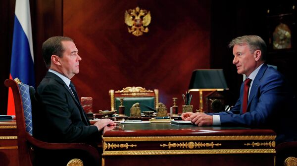 Председатель правительства РФ Дмитрий Медведев и президент, председатель правления Сбербанка России Герман Греф во время встречи