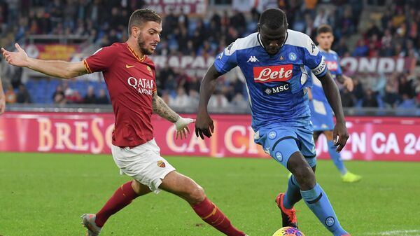 AS Roma's Italian defender Davide Santon fights for the ball with Napoli's Senegalese defender Kalidou Koulibaly during the Italian Serie A football match between AS Roma and Napoli at the Olympic stadium in Rome, on November 2, 2019. (Photo by Tiziana FABI / AFP)