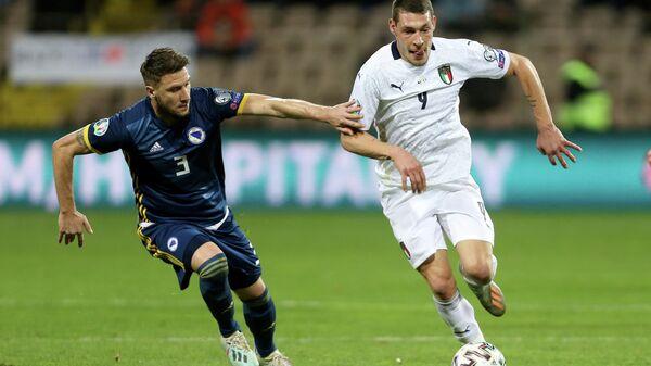 Игровой момент матча Босния и Герцеговина - Италия