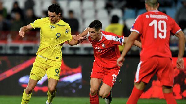 Игровой момент матча Сербия - Украина