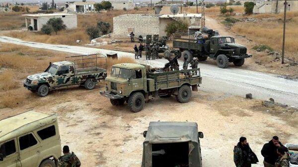 Военнослужащие сирийской армии в провинции Идлиб после освобождения от террористов населенного пункта Ум-эль-Халахель