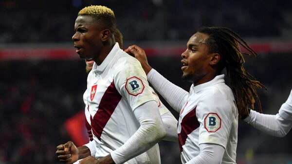 Lille's Nigerian forward Victor Osimhen (L) celebrates with teammates after scoring a goal during the French L1 football match between Lille (LOSC) and Dijon (DFCO) at the Pierre-Mauroy Stadium in Villeneuve d'Ascq, near Lille, northern France, on November 30, 2019. (Photo by DENIS CHARLET / AFP)