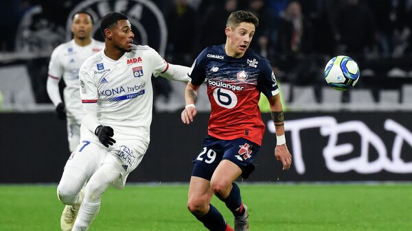 Lyon's French midfielder Jeff Reine-Adelaide (L) fights for the ball with Lille's Croatian defender Domagoj Bradaric (R) during the French L1 football match between Lyon (OL) and Lille (LOSC) at the Groupama stadium in Decines-Charpieu near Lyon, southeastern France, on December 3, 2019. (Photo by JEAN-PHILIPPE KSIAZEK / AFP)