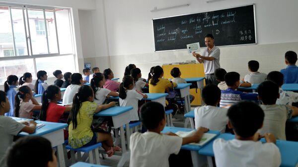 Дети во время урока в одной из школ Китая