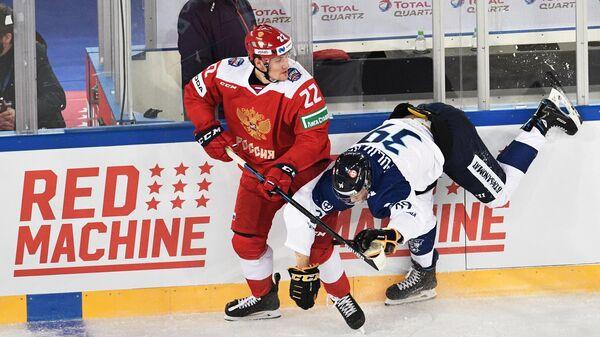 Защитник сборной России Андрей Миронов и форвард сборной Финляндии Ессе Пульюярви