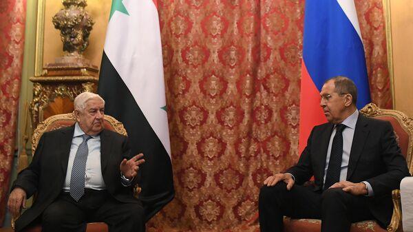 Министр иностранных дел РФ Сергей Лавров и министр иностранных дел Сирии Валид Муаллем во время встречи