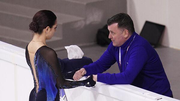 Евгения Медведева и ее тренер Брайан Орсер