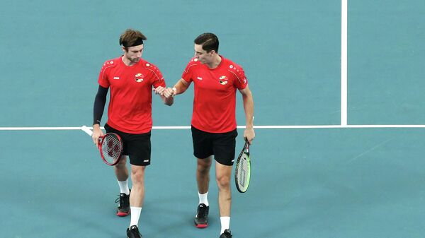 Сандер Жилле и Йоран Флиген в игре за Бельгию против Молдавии на Кубке ATP в Австралии