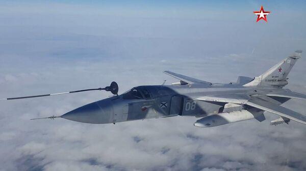 Дозаправку самолетов Су-30СМ и Су-24М в воздухе сняли на видео