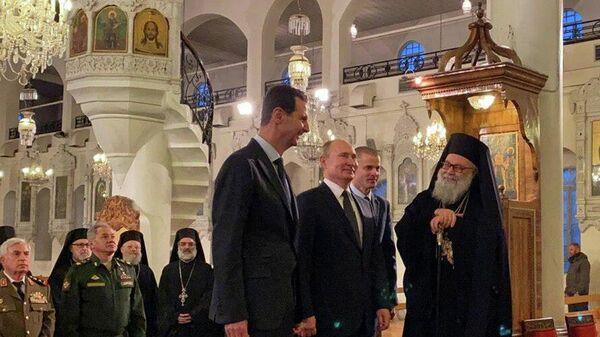 Президент России Владимир Путин и президент Сирийской Арабской Республики Башар Асад в Соборе Святой Девы Марии в Дамаске, Сирия. 7 января 2020