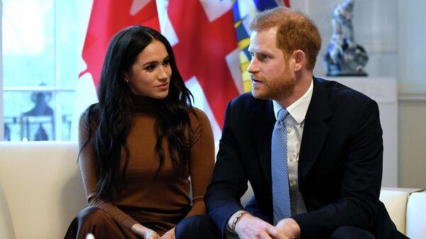 Британский принц Гарри и Меган, герцогиня Сассексская, во время посещения Канадского дома в Лондоне. 7 января 2020