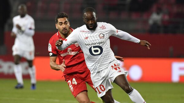 Lille's French forward Jonathan Ikone (R) vies with Dijon's French defender Wesley Lautoa (L) during the French L1 football match between Dijon Football Cote-D'Or and Lille LOSC at the Gaston Gerard stadium in Dijon, central France on January 12, 2020. (Photo by PHILIPPE DESMAZES / AFP)
