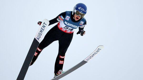 Прыгунья на лыжах с трамплина Ева Пинкельниг  (Австралия)