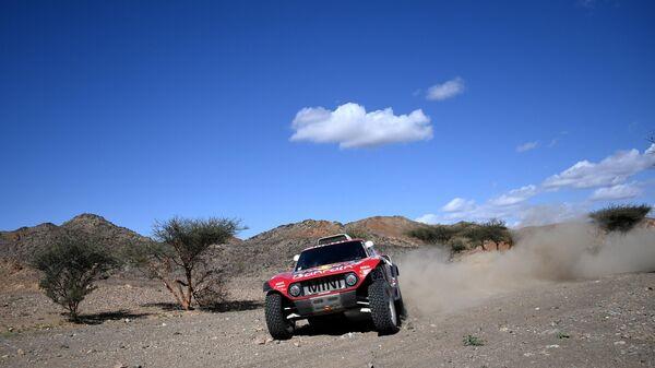 Bahrain JCW X-Raid team Spanish drivers Carlos Sainz of Spain and co-driver Lucas Cruz of Spain compete during the Stage 1 of the Dakar 2020 between Jeddah and Al Wajh, Saudi Arabia, on January 5, 2020. (Photo by FRANCK FIFE / AFP)