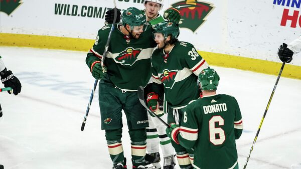 Jan 18, 2020; Saint Paul, Minnesota, USA; Minnesota Wild forward Ryan Hartman (38) celebrates his goal with forward Jordan Greenway (18) during the third period against the Dallas Stars at Xcel Energy Center. Mandatory Credit: Brace Hemmelgarn-USA TODAY Sports