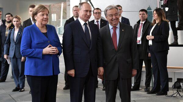 Президент РФ Владимир Путин, федеральный канцлер ФРГ Ангела Меркель и генеральный секретарь ООН Антониу Гутерреш на Международной конференции по Ливии