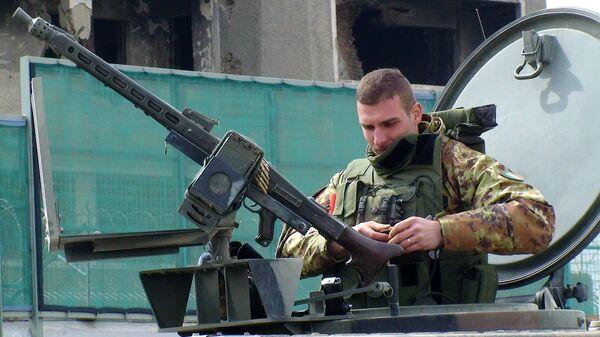 Итальянский пулеметчик из состава международных сил содействия безопасности в Афганистане (ISAF)