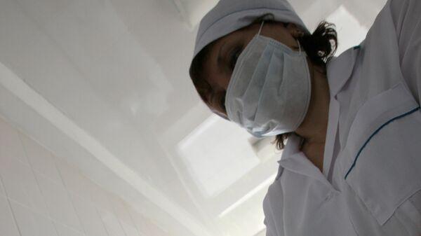 Медсестра в маске