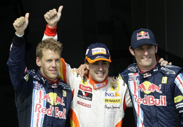 Пилоты формулы-1 Феттель, Алонсо и Уэббер (слева направо)