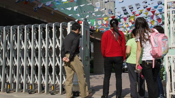Меры безопасности в Пекине после нападения на детский сад