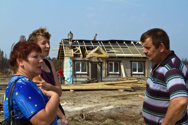 Начало работ по строительству новых домов для пострадавших от лесных пожаров. Архив