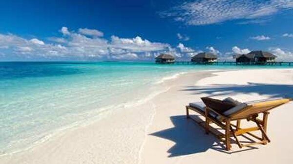 Виллы и пляж спа-отеля Conrad Maldives
