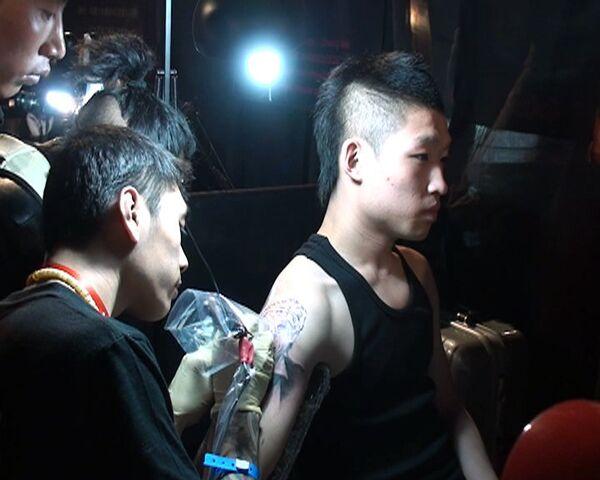 Мода на тату пришла в Китай с неожиданным размахом