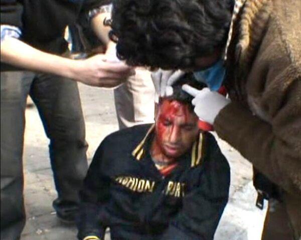 Столкновения сторонников и противников Мубарака продолжаются в Каире