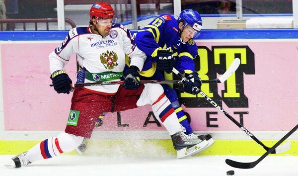 Евгений Артюхин и Том Ванделль (слева направо)