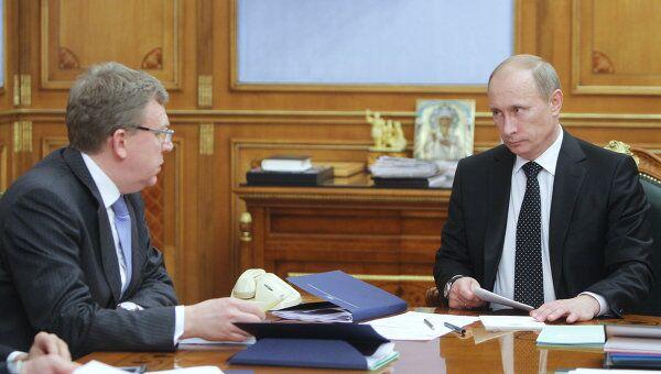Председатель правительства РФ Владимир Путин и министр финансов РФ Алексей Кудрин. Архив