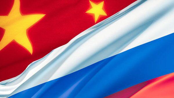 Флаги Китай, Россия. Коллаж РИА Новости