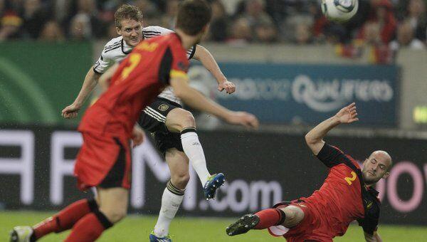 Игровой момент матча Германия - Бельгия