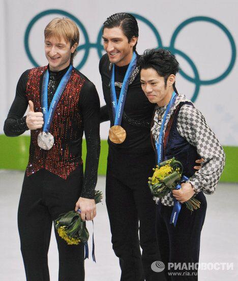 Евгений Плющенко, Эван Лайсачек и Дайсуке Такахаси (слева направо)