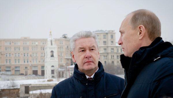 В.Путин и С.Собянин посещают место бывшей гостиницы Россия. Архив