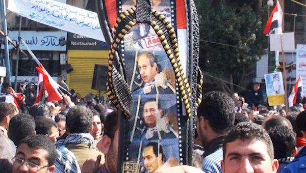 Шлепанцы с портретом Мубарака стали символом годовщины революции
