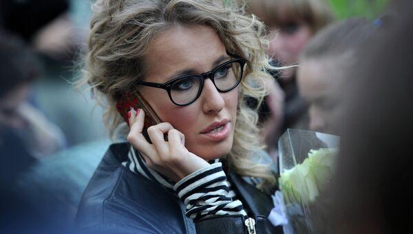 Телеведущая Ксения Собчак во время народных гуляний сторонников оппозиции на Чистопрудном бульваре