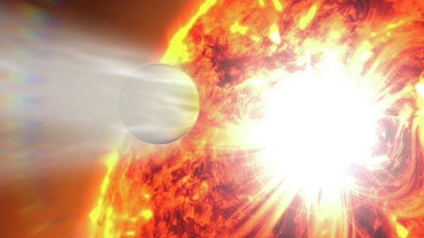 Испарение атмосферы планеты HD 189733b под действием сверхмощной вспышки на звезде