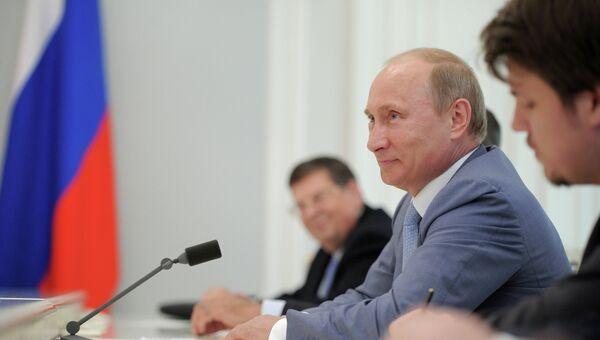 В.Путин встретился с К.Гэмбой