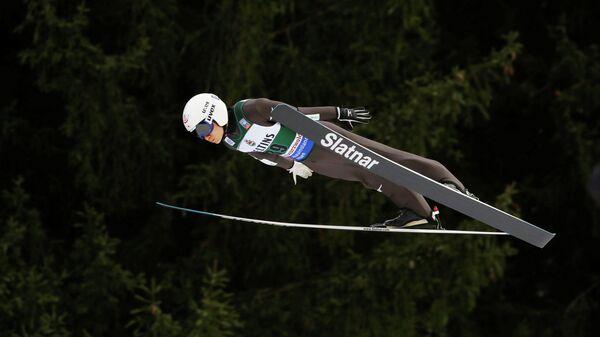 Японский прыгун с трамплина Юкия Сато